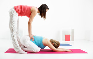 Beautiful pregnant woman is relaxing with her personal trainer.